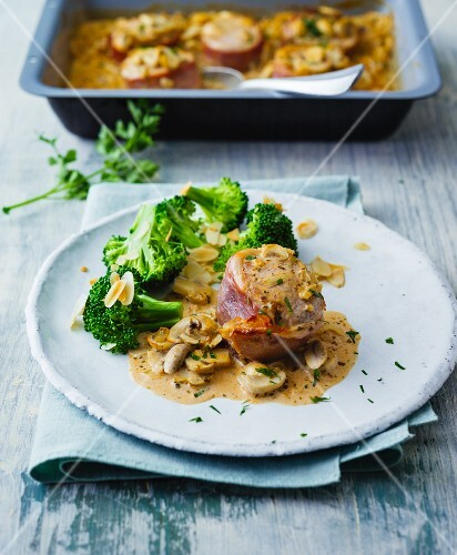 Pork fillet wrapped in ham with creamy mushrooms and almond broccoli