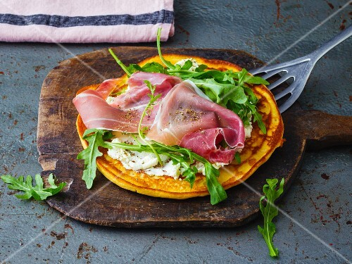 A savoury soya pancake with cream cheese, rocket and Parma ham