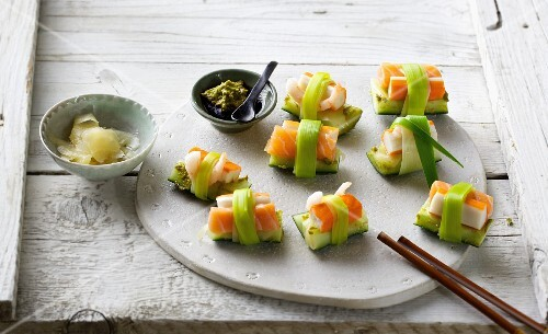 Sushi with surimi and cucumber tied with leek