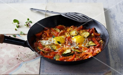 Fried peppers with fried eggs