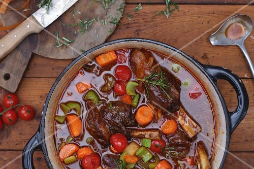 Vegetable stew with leg of lamb and rosemary