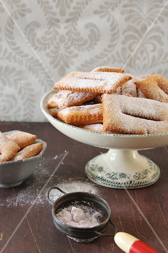 Chiacchiere (deep-fried Italian pastries) with icing sugar