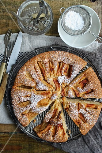 Apple cake with icing sugar, sliced