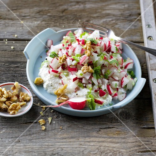 Fresh radish tatar with ricotta and walnuts