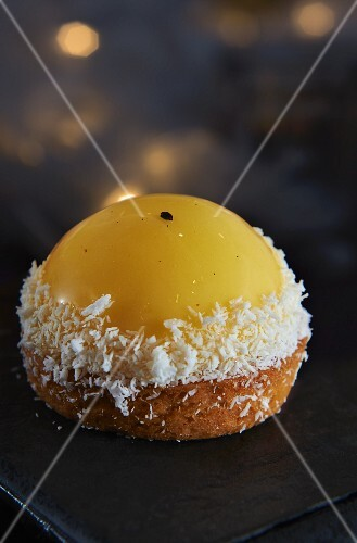 A lemon cake with grated coconut