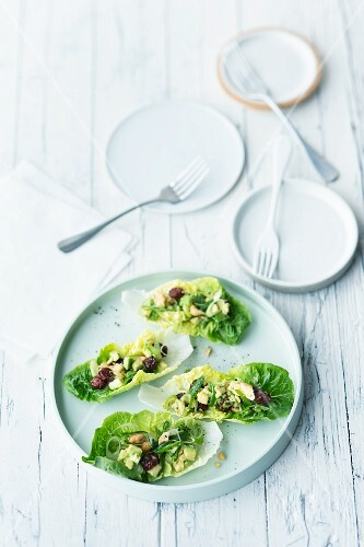 Cos lettuce leaves filled with avocado and cashew nut salad