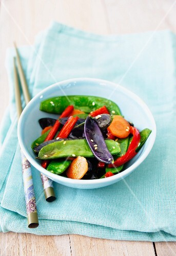 Fried purple and green mange tout with carrots and chilli