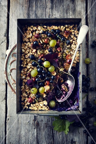Baked oats with gooseberries and blackcurrants