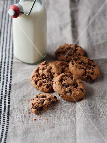 Chocolate chip cookies and a bottle of milk