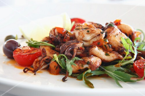 Stir-fried seafood with rocket