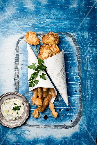 Fish tempura with potato and onion fritters and a herb dip