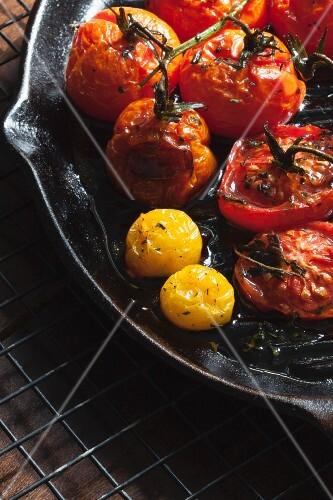 Roasted red and yellow tomatoes in a cast iron pan