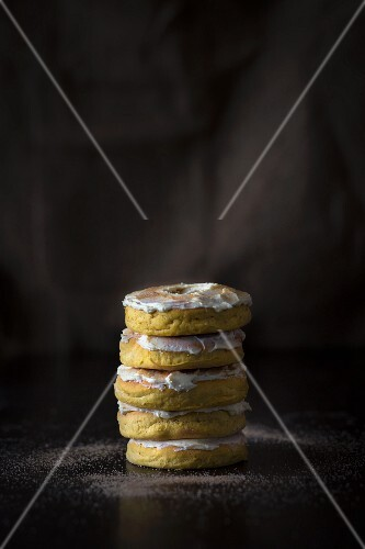 A stack of pumpkin doughnuts with icing and cinnamon sugar