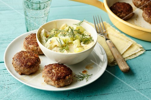 Mini meatballs made from tatar with a cucumber and dill salad