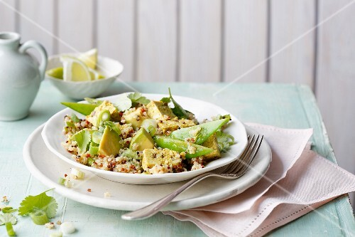 Quinoa and avocado salad with curry and mango tofu