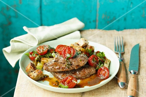 Beef fillet with braised cherry tomatoes and fresh herbs