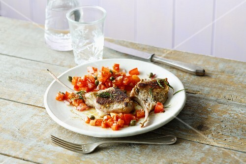 Fried lamb chops with a tomato and caper salsa