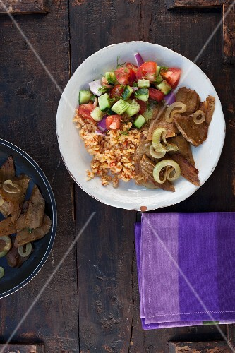 Vegetarian seitan kebabs with tomato bulgur and a salad