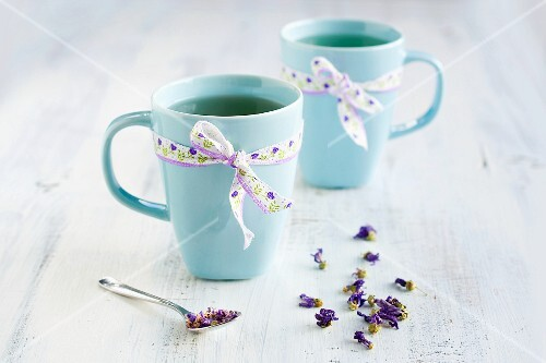 Mallow tea in two light-blue cups