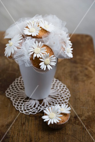 A bunch of cupcake flowers on a doily