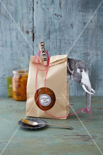 Jam in a paper bag decorated with an elephant as a gift