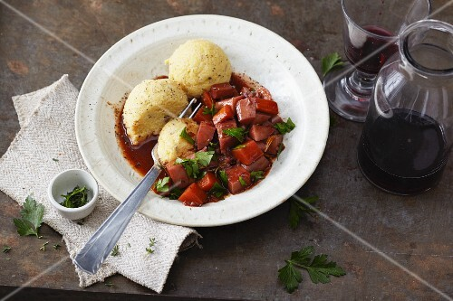 Vegetarian red wine root vegetables with porcini mushroom polenta