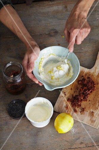 Goat's cream cheese being mixed with lemon zest