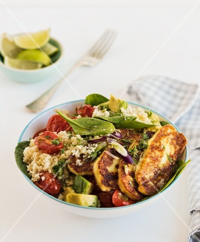 Halloumi with couscous, avocado and tomatoes