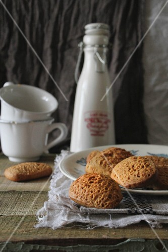 Nut biscuits on a plate in front of two coffee cups