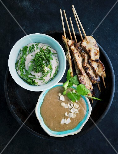 Chickens sate skewers with a bean mousse and peanut sauce