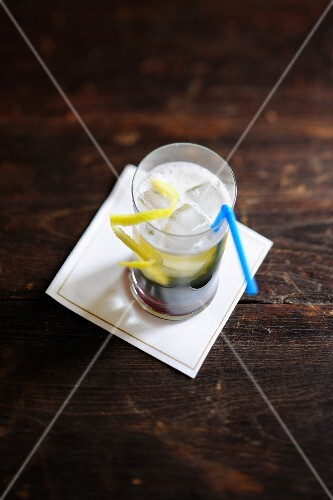 Beer with lemon zest and ice cubes