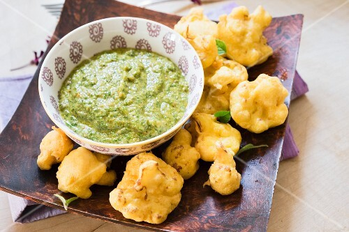 Fried cauliflower with a green herb sauce