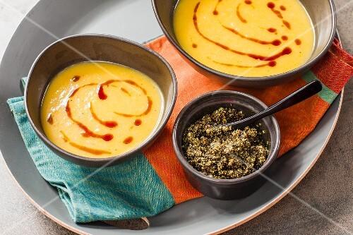 Vegan pumpkin soup with a pumpkin seed paste