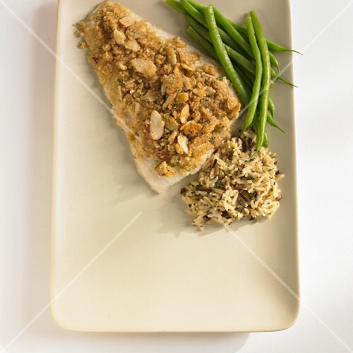 Haddock with an almond and breadcrumb coating served with green beans and rice