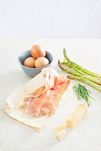 Ingredients for asparagus and Parma ham rolls and Parmesan oeuf cocotte