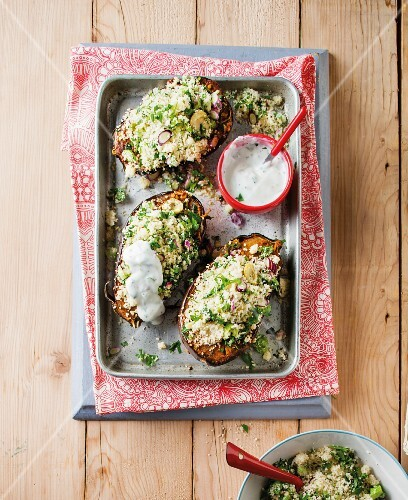 Stuffed aubergines with herb couscous