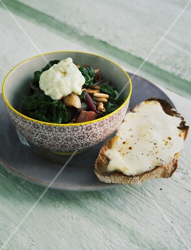 Chard with pine nuts and taleggio crostini