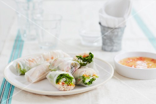 Rice paper rolls filled with carrots, rice noodles, shrimps and chilli dip (Vietnam)