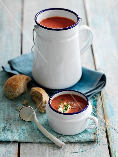 Cream of vegetable soup in an enamel jug and and an enamel mug