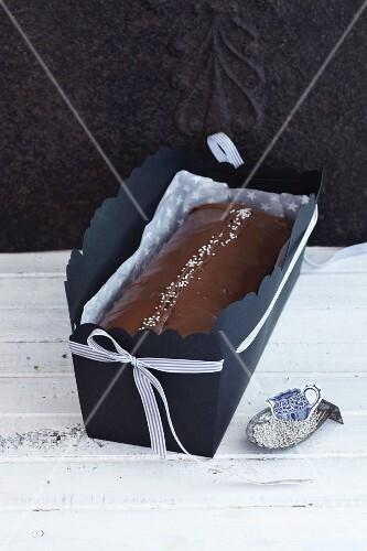 Nut cake with chocolate glaze as a gift