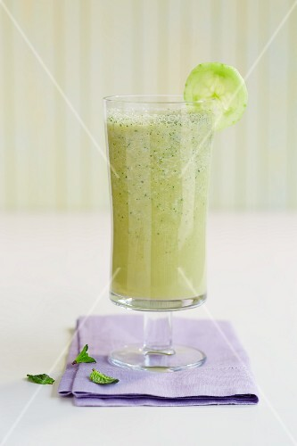A glass of cucumber and mint smoothie