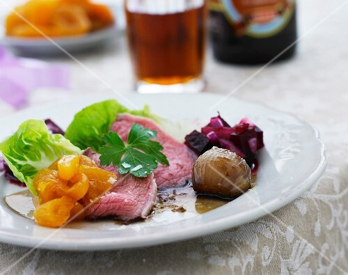 Roast beef with beetroot salad, apricots and red wine onions