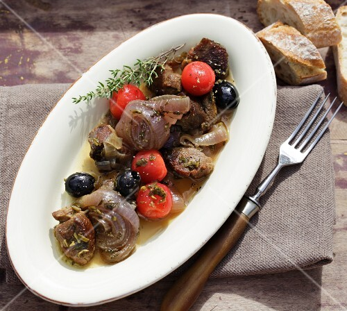 Braised lamb stew with onions, olives and cherry tomatoes