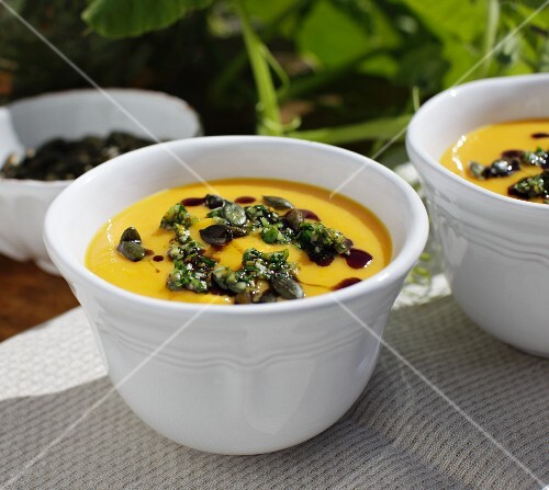 Cream of pumpkin soup with orange and lamb's lettuce gremolata