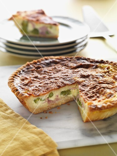 Asparagus and ham quiche, sliced