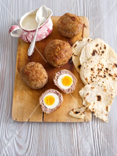 Scotch eggs with horseradish sauce and unleavened bread