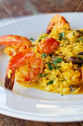 Saffron rice with shrimps, porcini mushrooms and cherry tomatoes