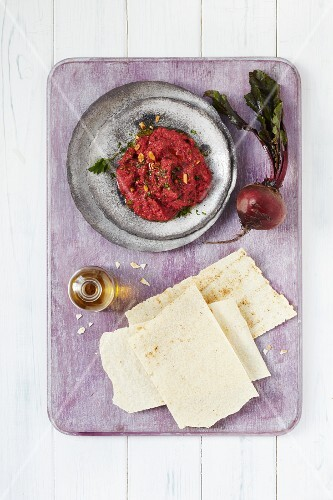 Beetroot hummus served with pita bread