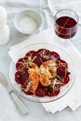 Beetroot carpaccio with smoked salmon, cress and capers