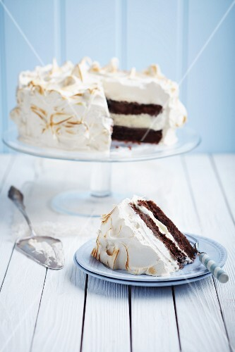 Chocolate layer cake with a meringue topping